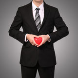 Man in suit with red heart Stock Photos