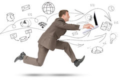 Man in suit running with laptop on white Royalty Free Stock Images