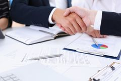 Man in suit shake hand as hello in office. Closeup. Friend welcome mediation offer positive introduction greet or thanks gesture summit participate approval Stock Photo