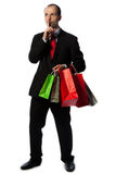 Man in suit with shopping bags Stock Photos