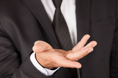 Man with suit show hand Royalty Free Stock Photography