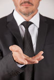 Man with suit show hand Stock Photography