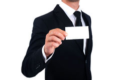 Man in suit showing business card Stock Image
