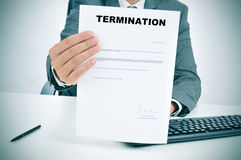 Man in suit showing a figured signed termination document Royalty Free Stock Photography