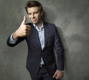 Man in suit showing the OK gesture Royalty Free Stock Photography