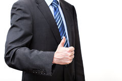 Man in a suit showing OK Royalty Free Stock Image