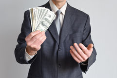 Man in a suit shows money Stock Photography