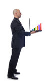 Man in suit side view laptop. Man presenting laptop growth chart  in side view on white background Stock Images