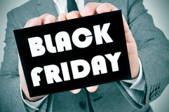 Man in suit with a signboard with the text black friday Royalty Free Stock Photos
