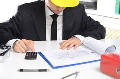 Man in suit signing documents Stock Photo