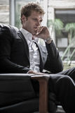 Young man in suit thinking Royalty Free Stock Images