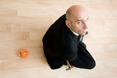 Man in suit sitting on floor Royalty Free Stock Photography