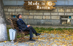 Man in Suit Smoking in Russia Royalty Free Stock Photos