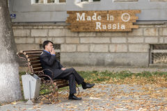Man in Suit Smoking in Russia Royalty Free Stock Photo