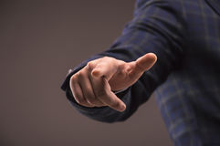 Man in a suit specifies a finger Royalty Free Stock Photo