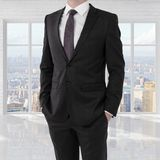 Man in suit. Standing in brick room Royalty Free Stock Photos