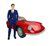 Man in suit standing next to red retro sport car Stock Image