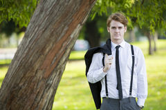Man in suit standing in park Stock Photography