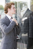 Man in suit at a storefront Stock Photo