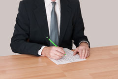 Man in suit studying spreadsheet / schedule Stock Photography