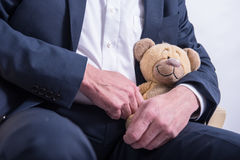 Man in suit with a stuffed animal Stock Image