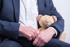 Man in suit with a stuffed animal Royalty Free Stock Photo