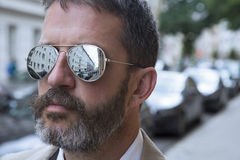 Man in suit with sunglasses in the street Stock Photo
