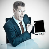 Man in suit with tablet Royalty Free Stock Image