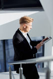 A man in a suit with  tablet in his hand  the office Royalty Free Stock Image