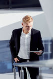A man in a suit with tablet in his hand the office Royalty Free Stock Photography