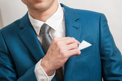 Man in suit taking out the pocket square Stock Images