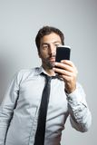 Man in suit taking a selfie Royalty Free Stock Photography