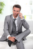 Man in a suit talking on cellphone Royalty Free Stock Photos