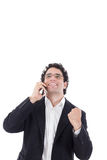 Man in a suit talking on the mobile and shows a sign of success Royalty Free Stock Image