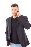 Man in a suit talking over mobile Royalty Free Stock Images