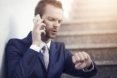 Man in suit talking on the phone Royalty Free Stock Image