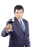 Man in a suit tasting wine Royalty Free Stock Photos