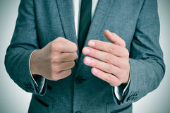 Man in suit with a threatening gesture Stock Photography