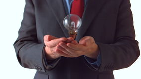 Man in suit throwing a bulb stock footage