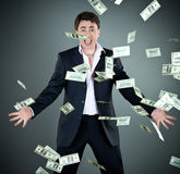 Man in a suit throws money Royalty Free Stock Image