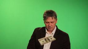 A man in a suit throws money. stock footage