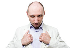 Man in suit with thumbs on the lapel Stock Photos