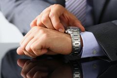 Man in suit and tie check out time at. Silver wristwatch closeup. Waste minute modern punctual life style start hurry job idea last second clockwork precision Stock Photo