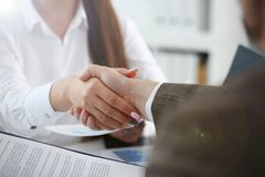 Man in suit and tie give hand as hello in office stock images