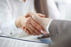 Man in suit and tie give hand as hello in office royalty free stock images