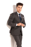 Man in suit and tie unbuttoning his coat Stock Photography
