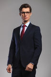 Man in suit and tie wearing glasses looks to side Stock Images