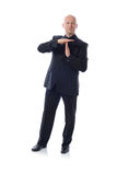 Man in suit time out. Man in suit giving time out sign  on white Stock Photography