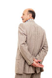 Man in the suit turned his back, taking  thoughtfully his wrist Stock Images