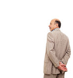 Man in the suit turned his back, taking  thoughtfully his wrist Royalty Free Stock Images
